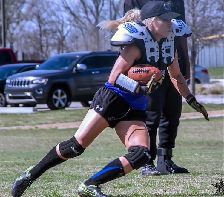 Cortnee White running the football.