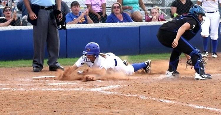Cortnee White playing college softball.